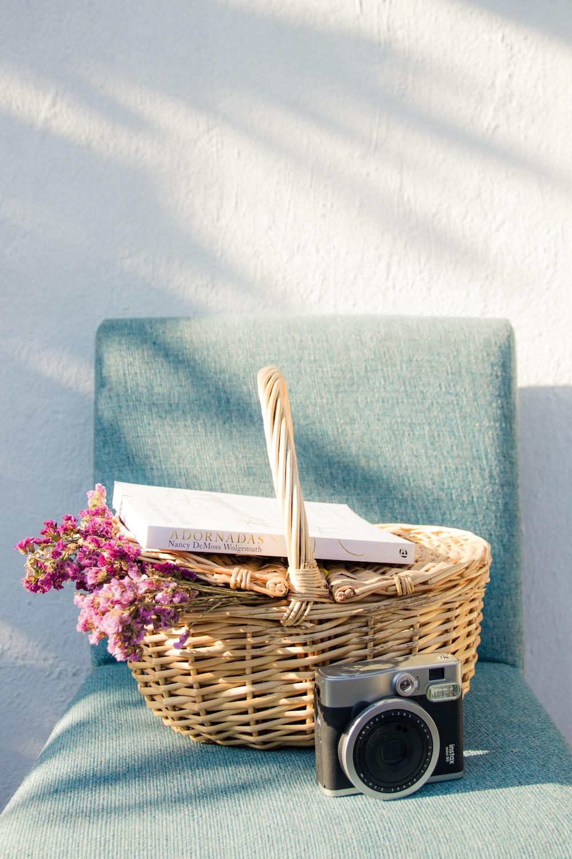 green towel on brown woven basket