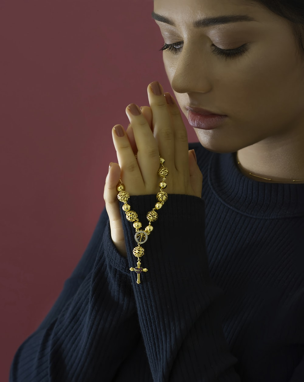 woman in black turtleneck sweater wearing gold necklace