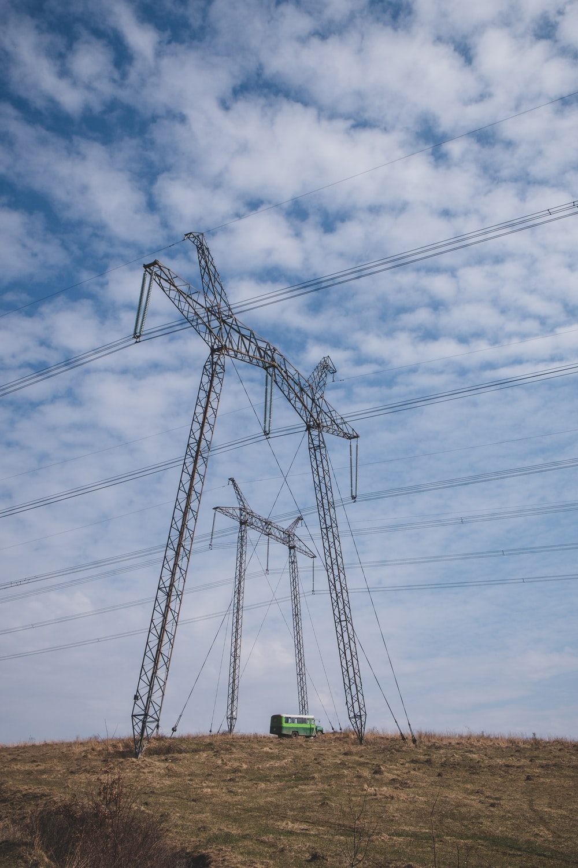 black electric post under blue sky during daytime