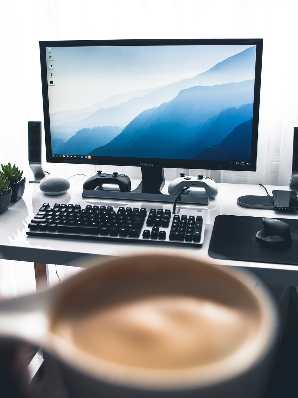 black flat screen computer monitor and black computer keyboard on white desk
