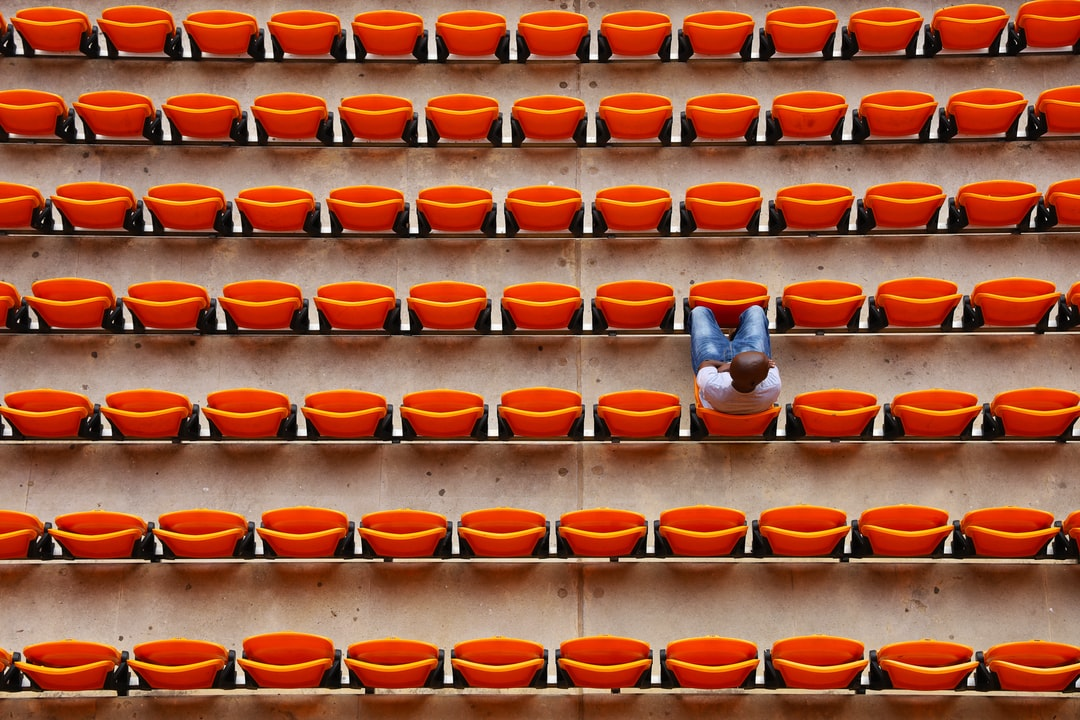 Man sitting in a seat at stadium