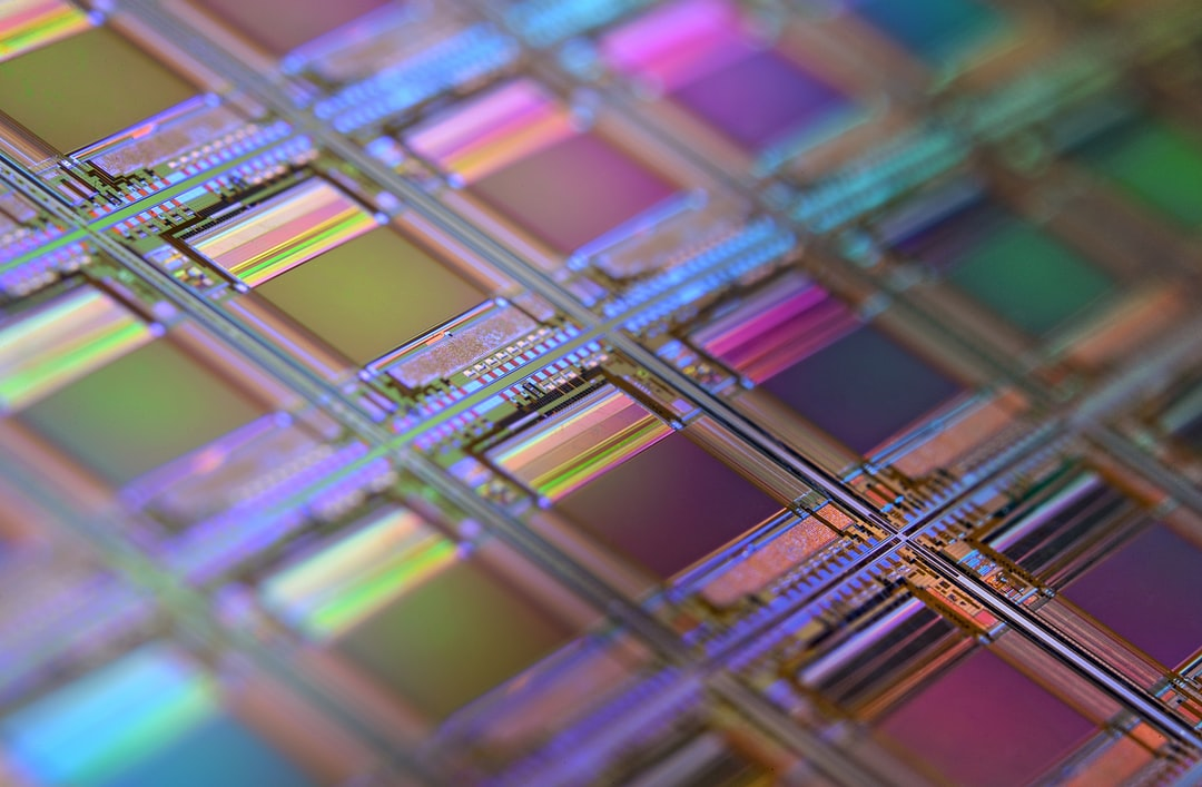 This is a macro of a silicon wafer. Each square is a chip with microscopic transistors and circuits. Ordinarily, wafers like these are diced into their individual chips and the chips go into the processors that power our computers. Sometimes, wafers have flaws and the manufacturers dispose of them instead. That's how I got mine. After visiting the tech museums in Silicon Valley, I was amazed at the beauty of silicon wafers, so I started collecting and photographing them. Like fractals and flowers, the closer you get to them, the more amazing details there are to see.