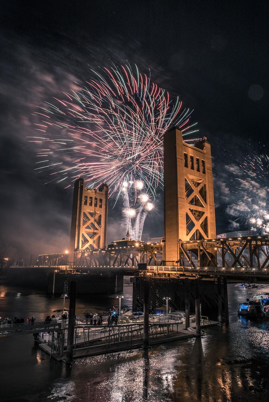 fireworks display over bridge during night time