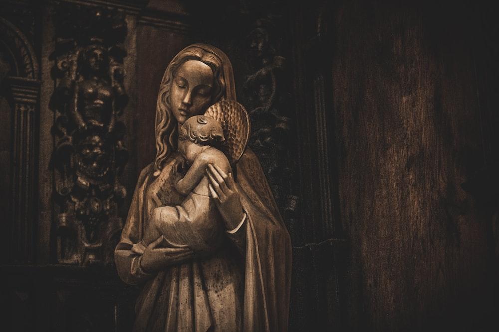 woman in dress holding heart figurine