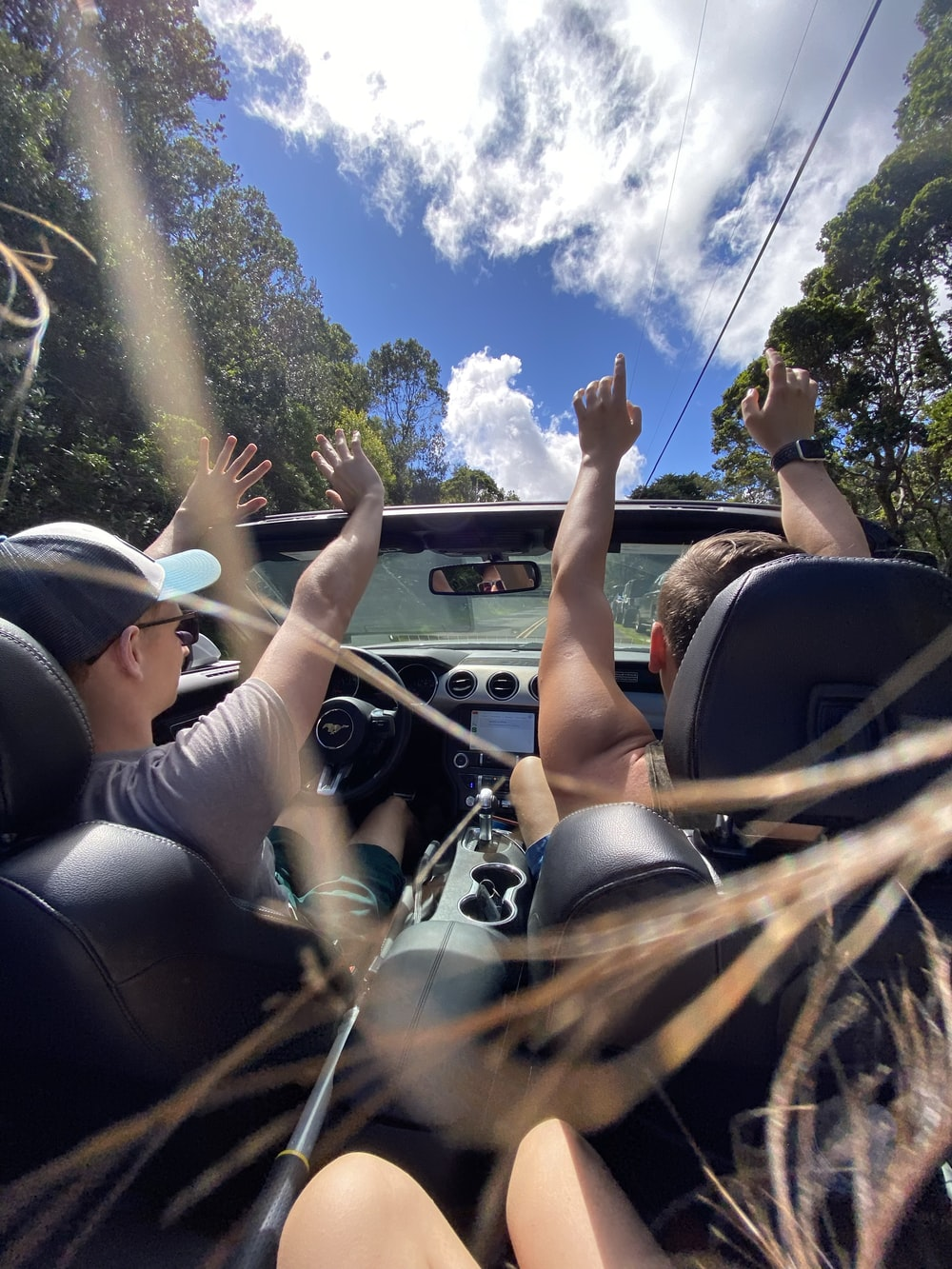 people riding on car during daytime