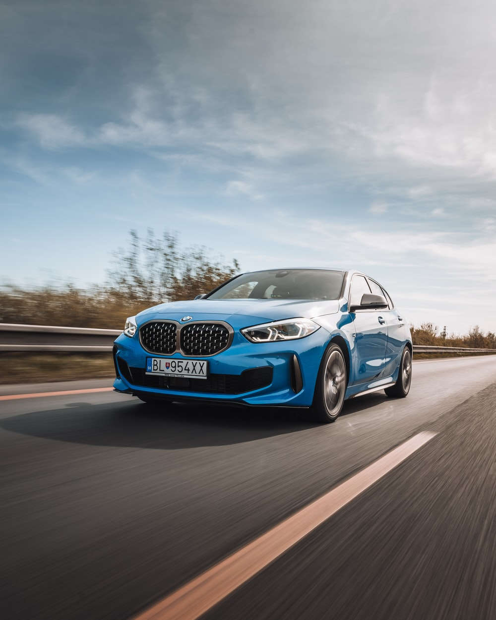 blue bmw m 3 on road during daytime