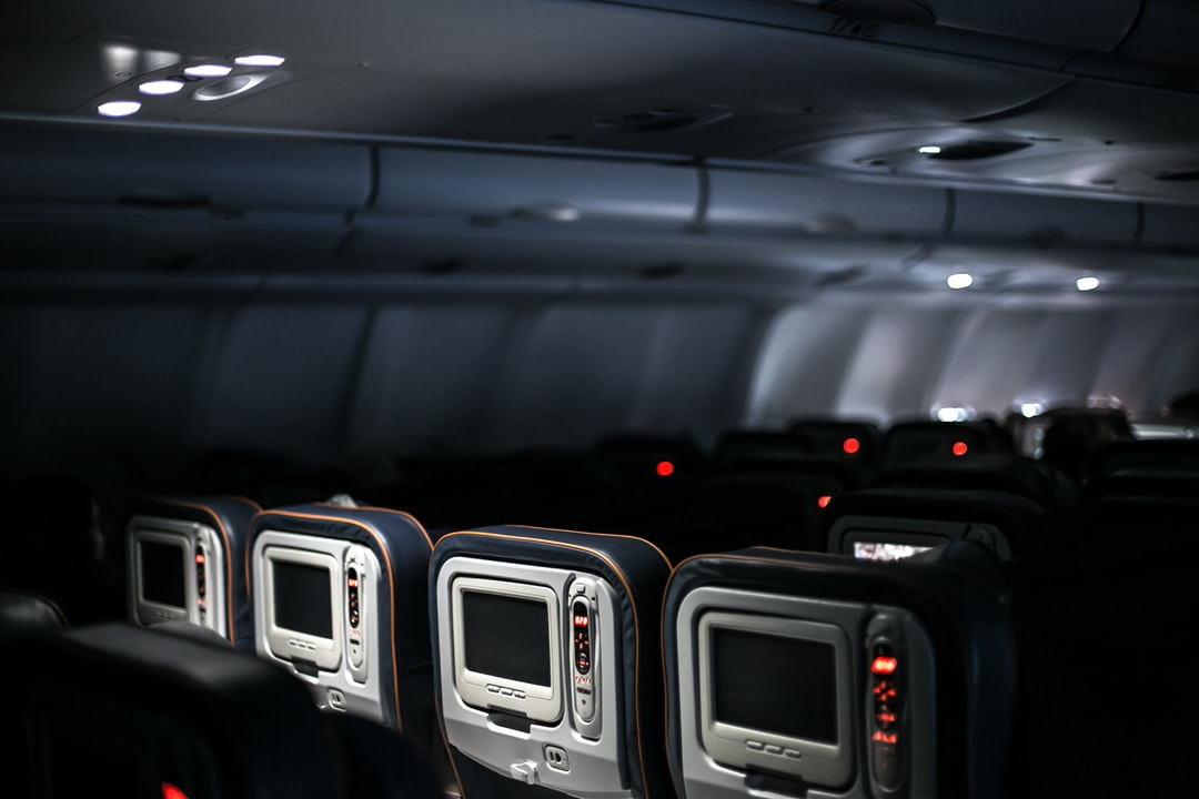 A plane's interior, with empty seats