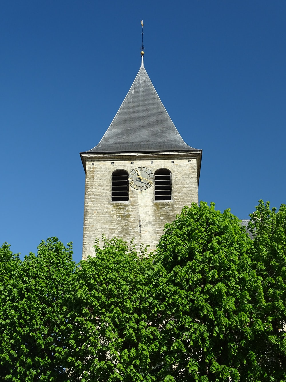 brown concrete church under blue sky during daytime