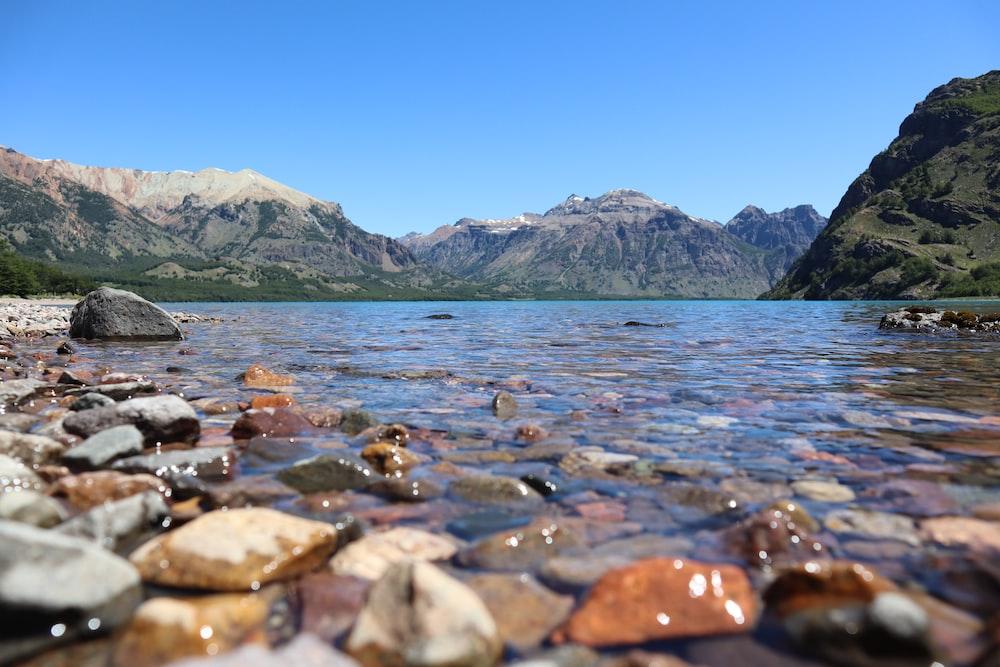 rocky shore near mountain during daytime