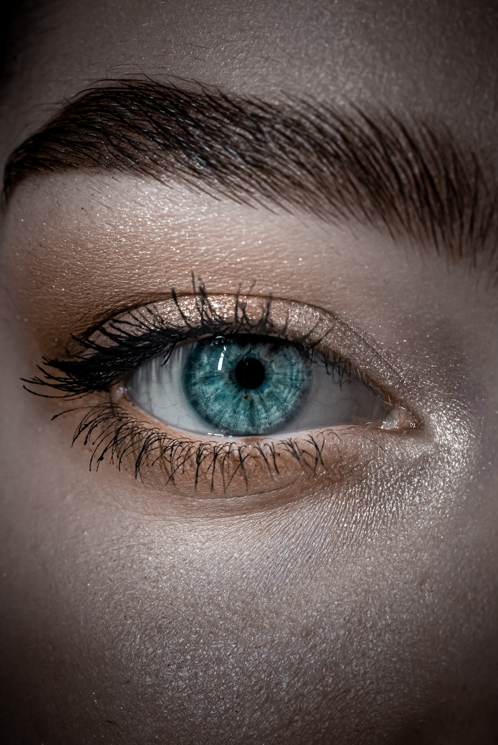 persons blue eyes in close up photography
