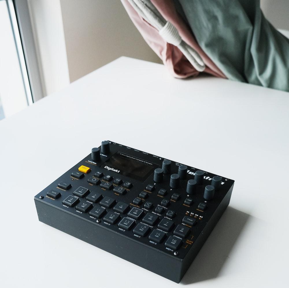 black audio mixer on white table