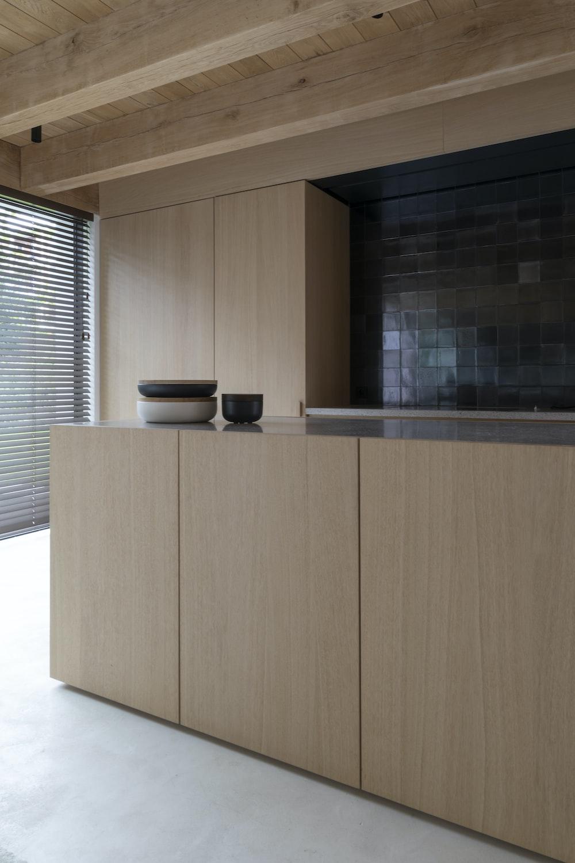 brown wooden cabinet near window