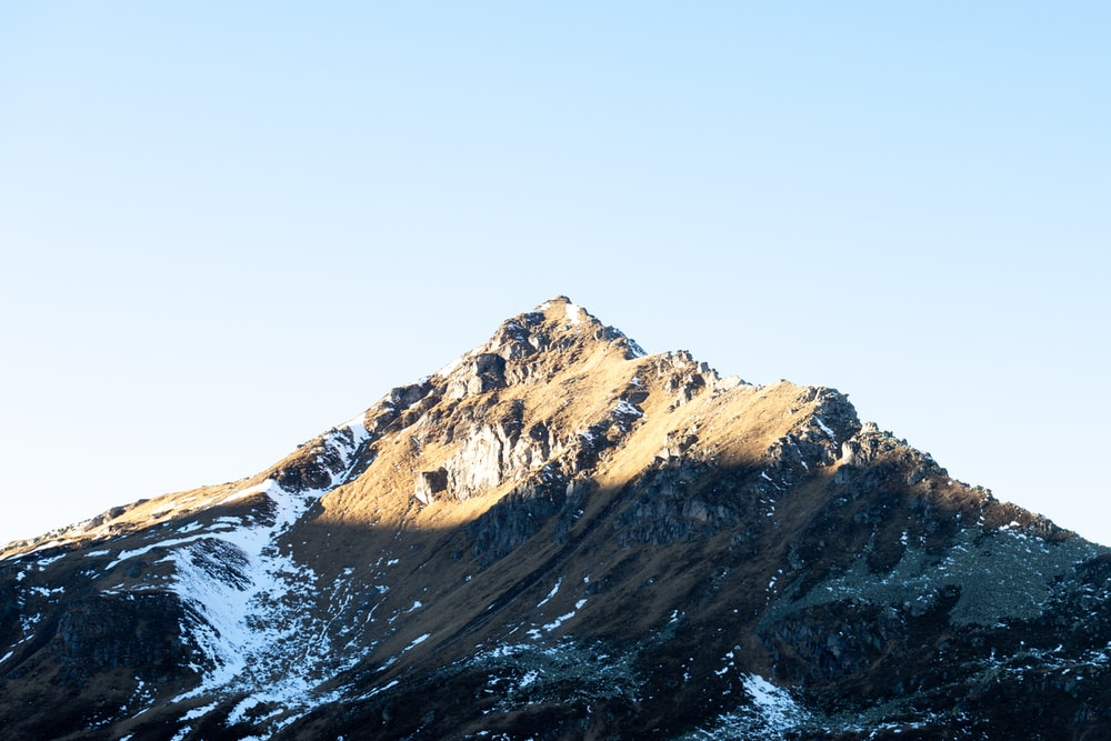 brown and white mountain under white sky during daytime