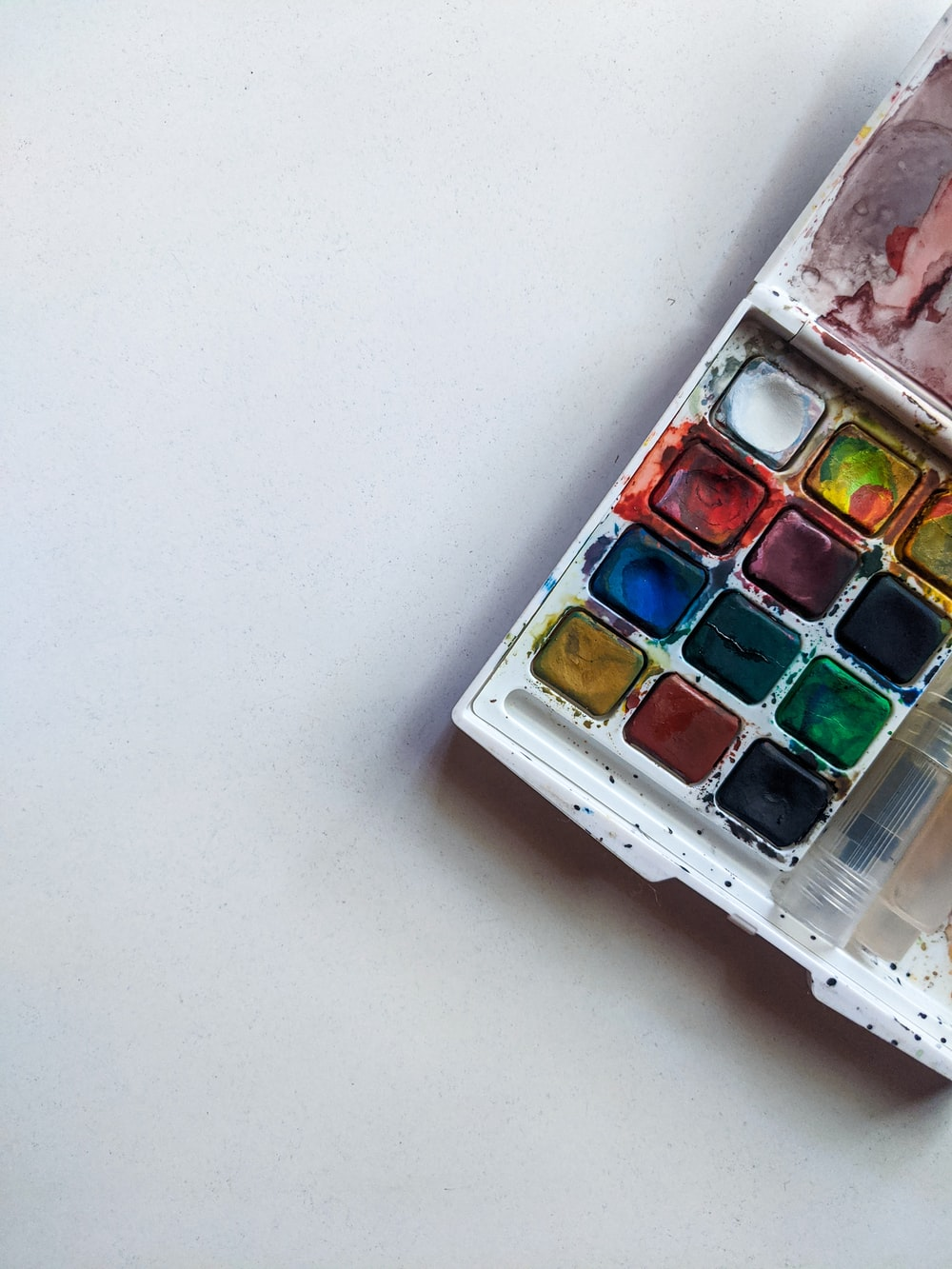 makeup palette on white table
