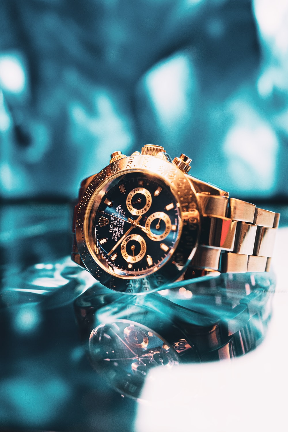 gold and silver chronograph watch