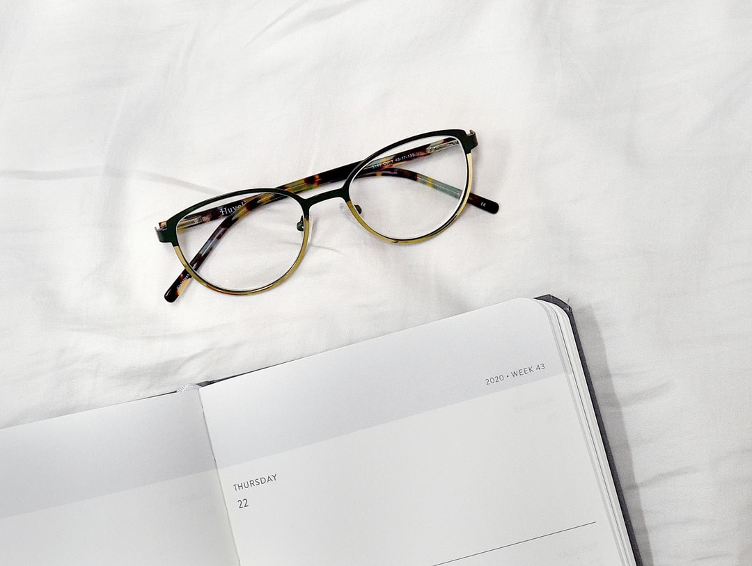 Baron Fig weekly planner with folded glasses