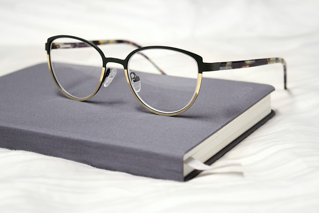 grey Baron Fig planner with glasses on top