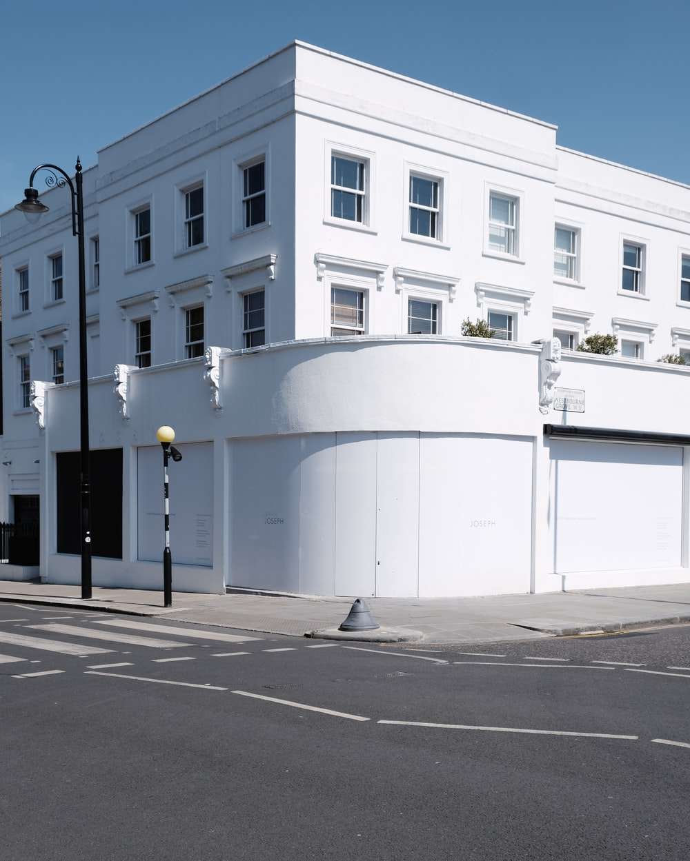 white concrete building near road during daytime