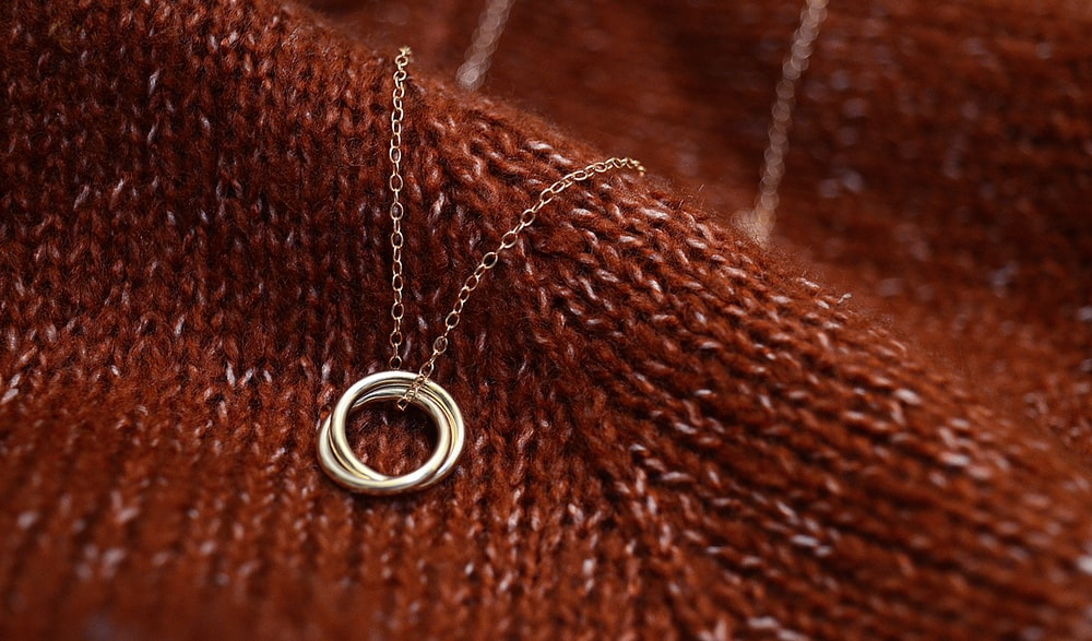 silver ring on brown textile
