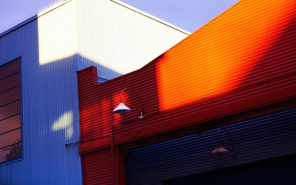 blue and orange building under blue sky during daytime
