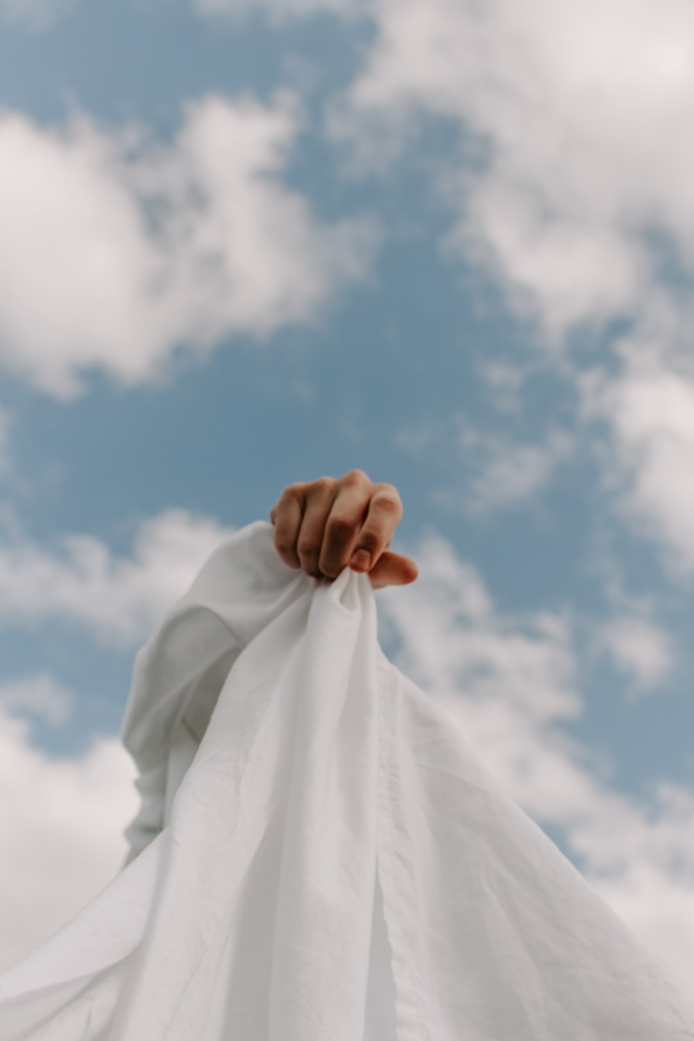 person in white dress shirt under blue sky during daytime