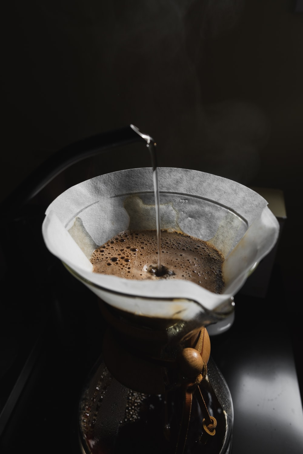 white and brown liquid in stainless steel cup