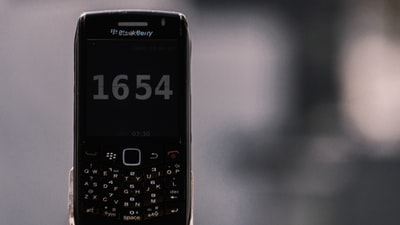 black nokia qwerty phone at 12 00