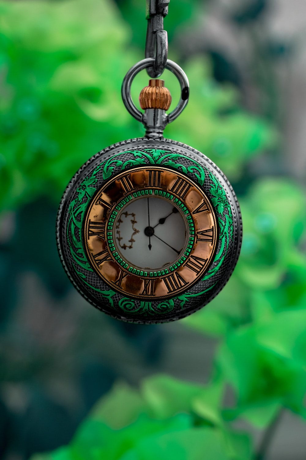 gold and silver pocket watch