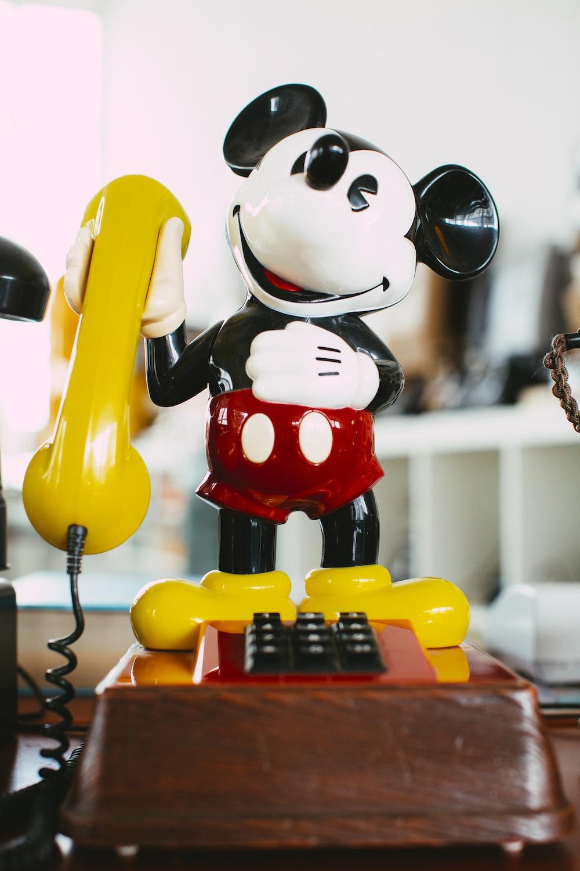 yellow haired girl holding telephone figurine
