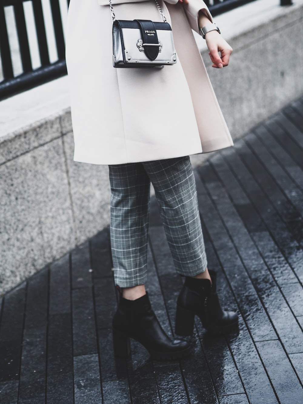 woman in blue denim jeans and black leather shoes