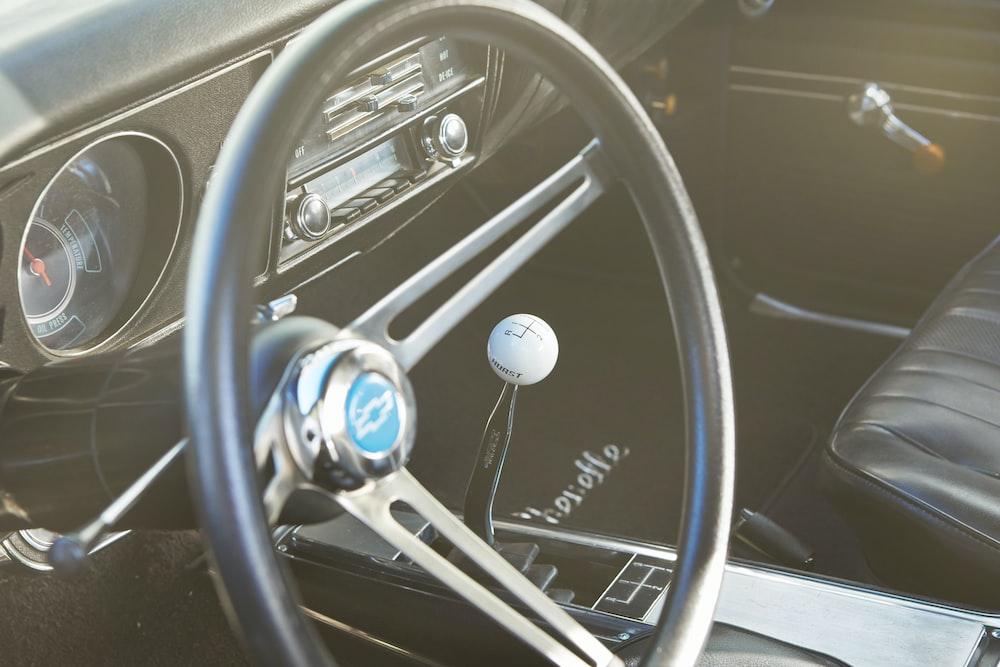 white steering wheel and car steering wheel