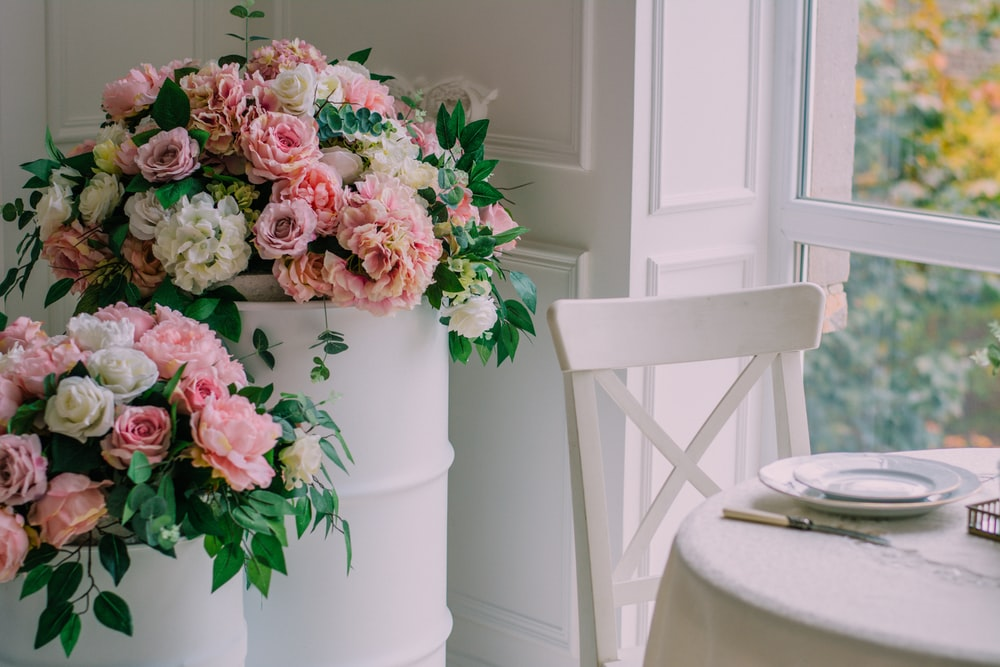 pink and white flowers on white table