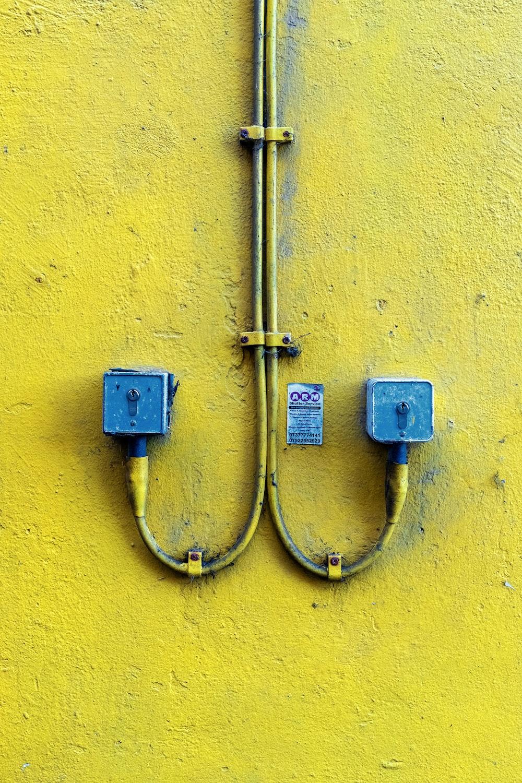 blue and yellow steel padlock