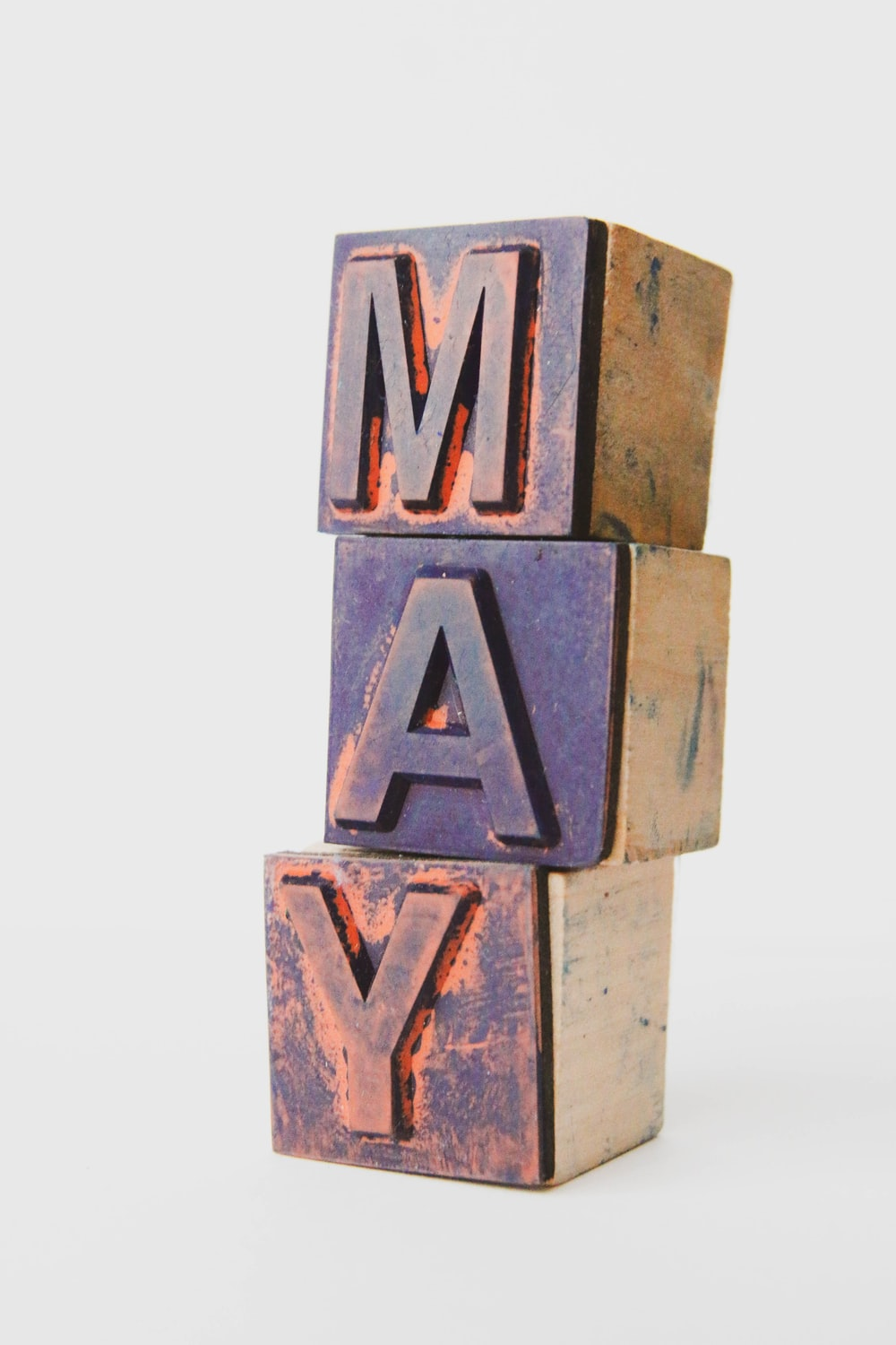 brown and white letter m wall decor