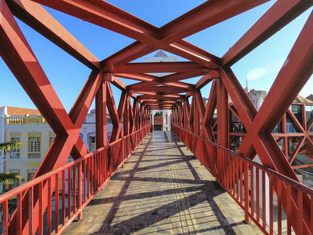 brown wooden bridge under blue sky during daytime