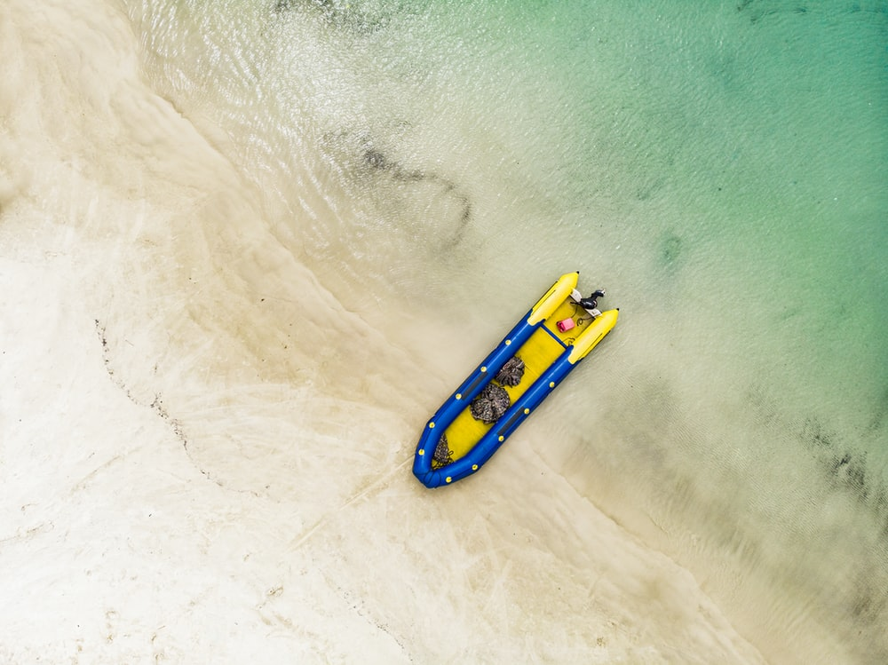 yellow and blue kayak on water