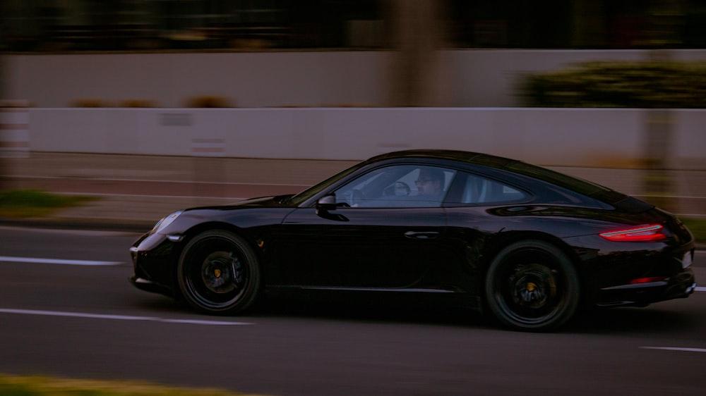 black porsche 911 parked on road