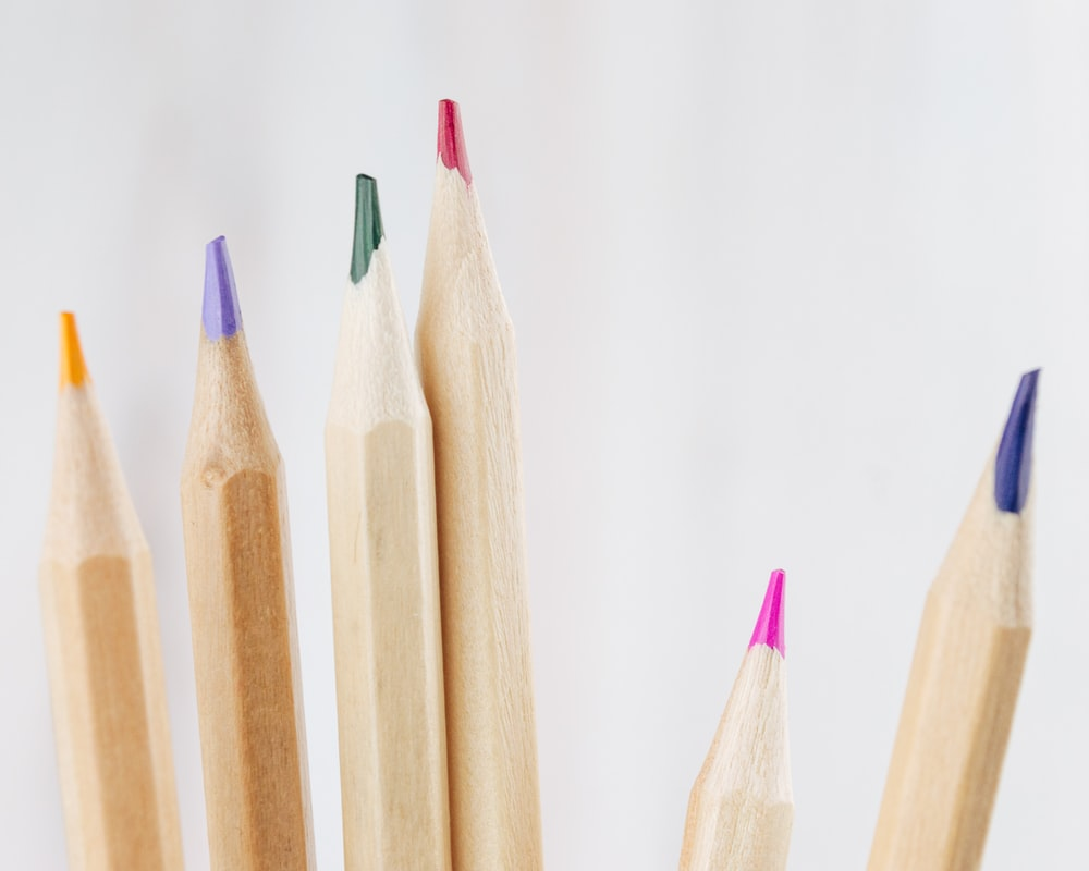 brown wooden pencils on white surface