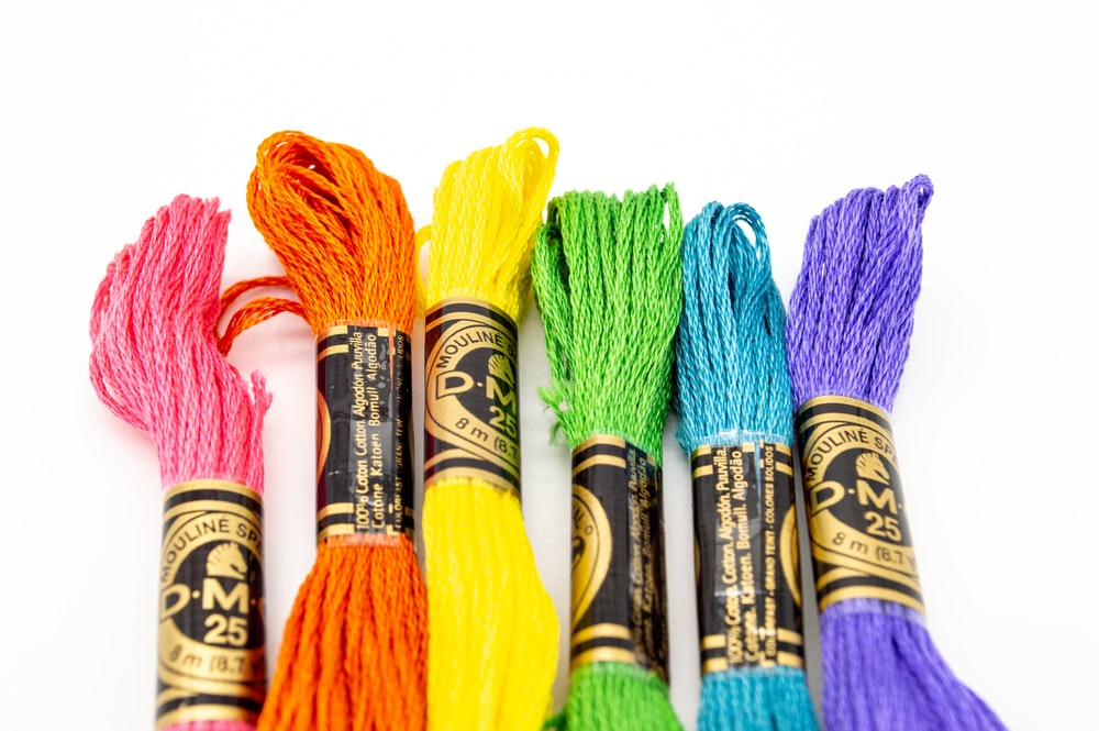 yellow blue and pink thread