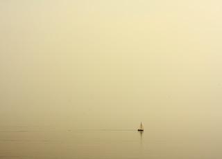 black sailboat on sea during daytime