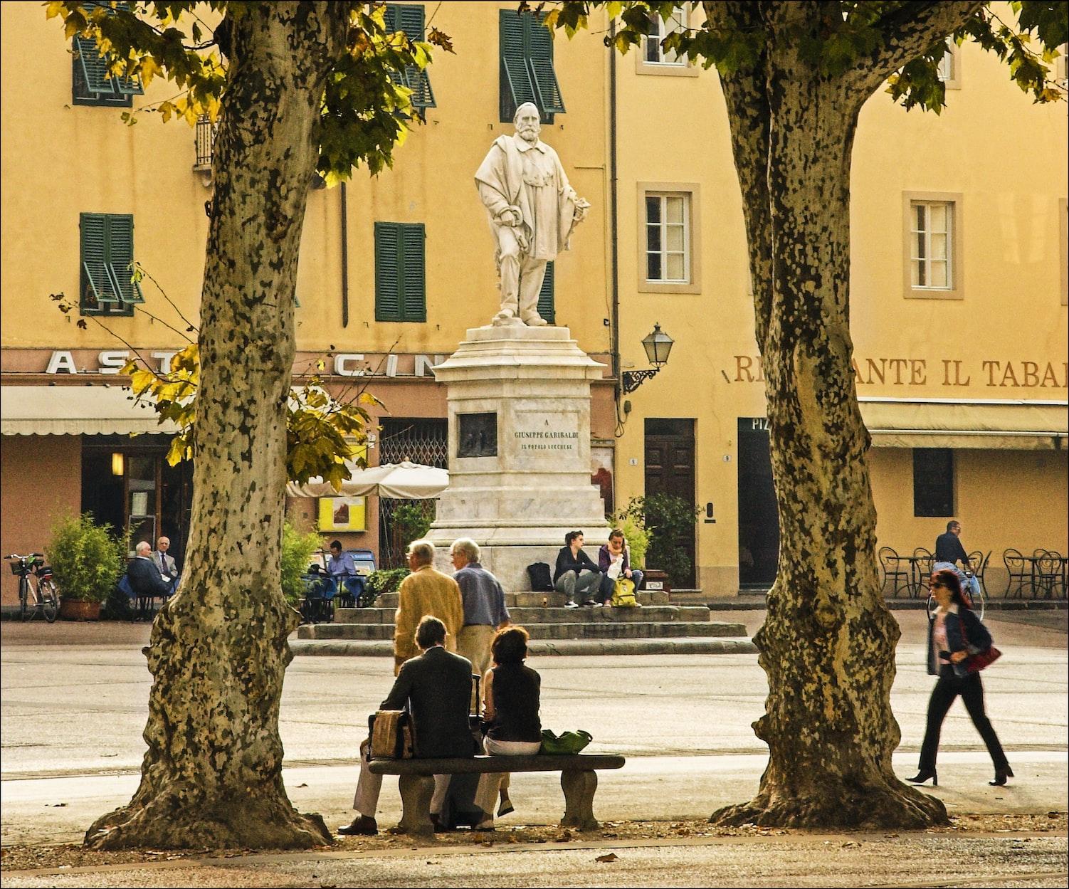statue in a public square in Lucca, Italy