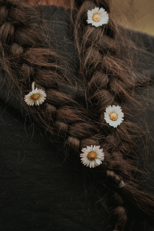 white daisy on black textile