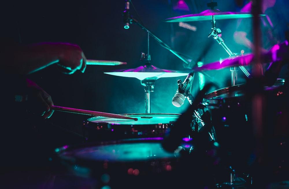 man playing drum set on stage