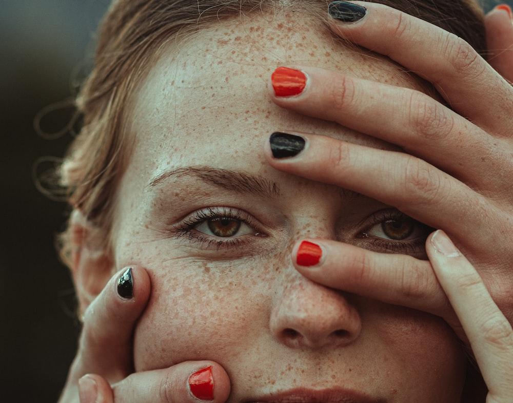 woman with red nail polish