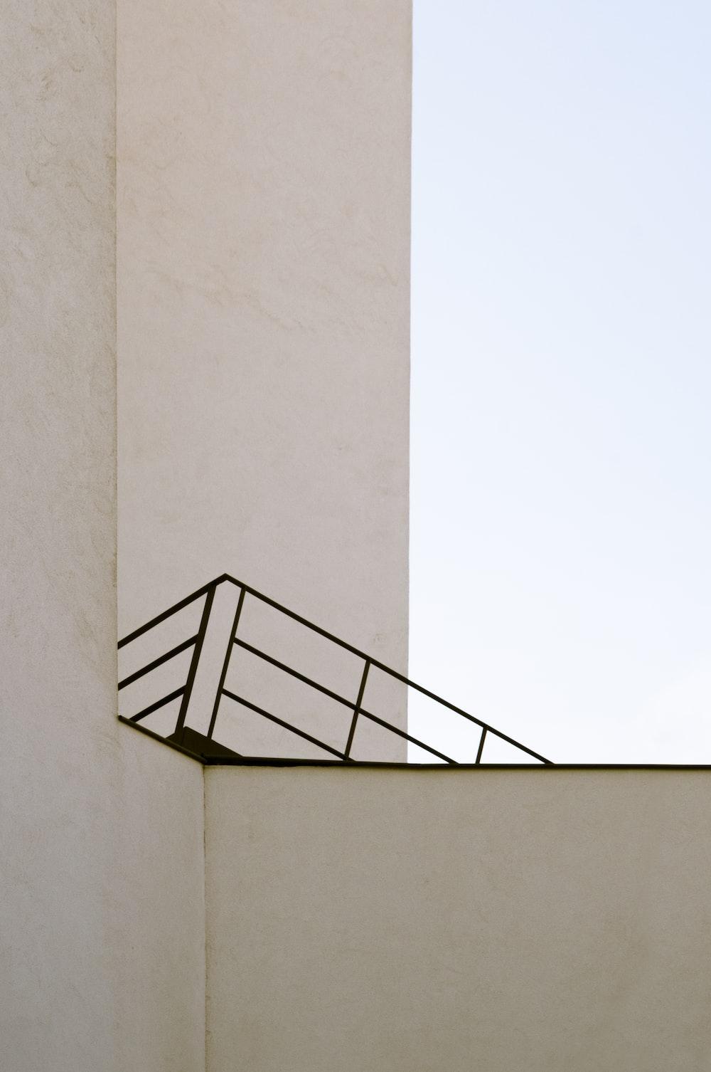 black metal staircase on white wall