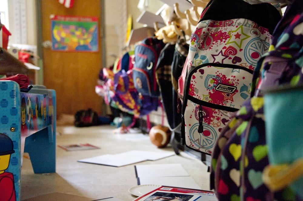 black yellow and red backpack on white table