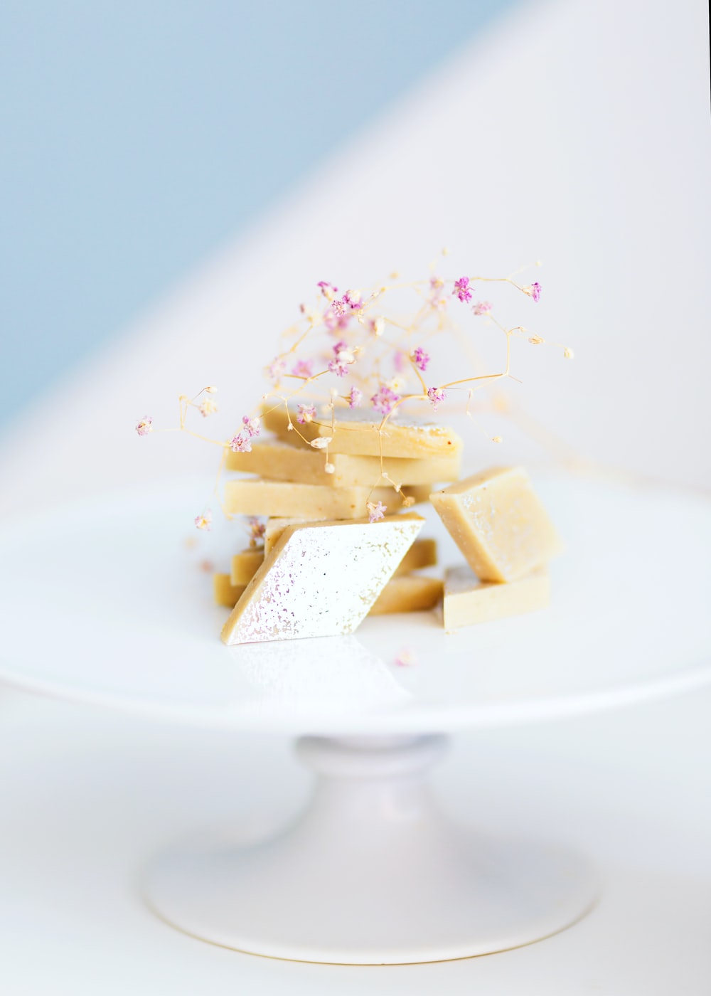 white and brown cake on white ceramic plate