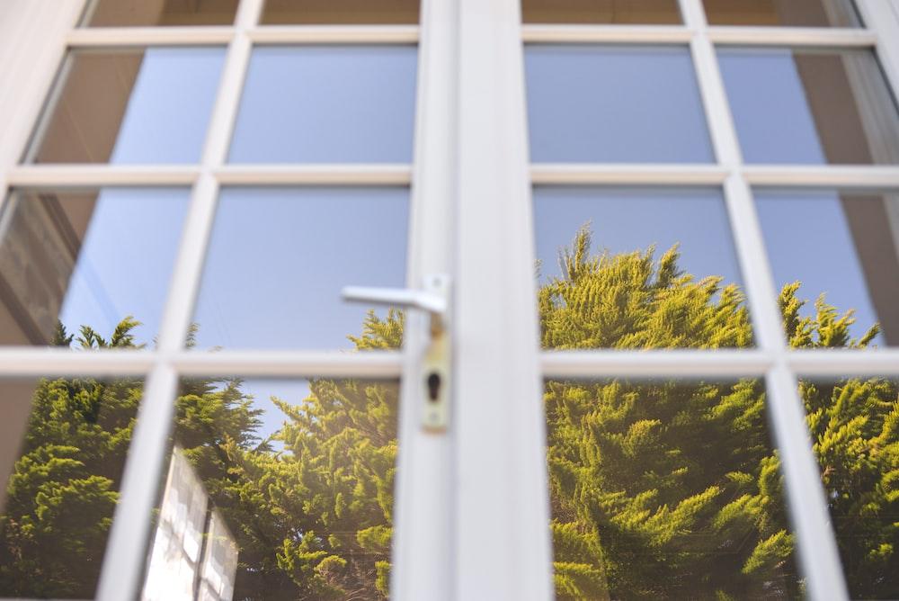white metal framed glass window