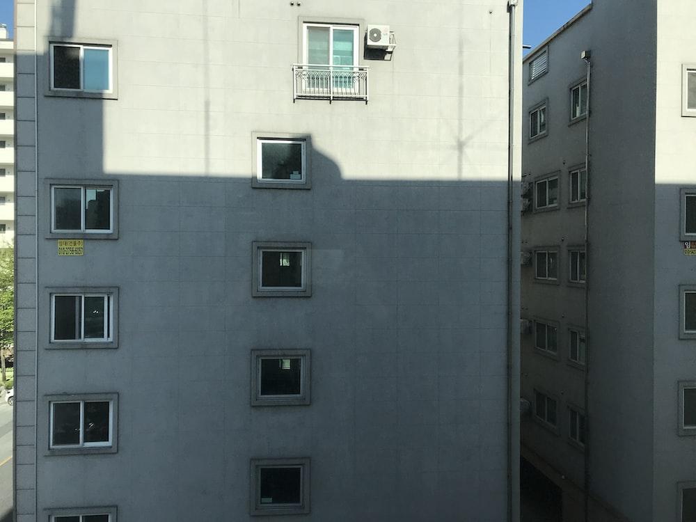 white concrete building with black windows