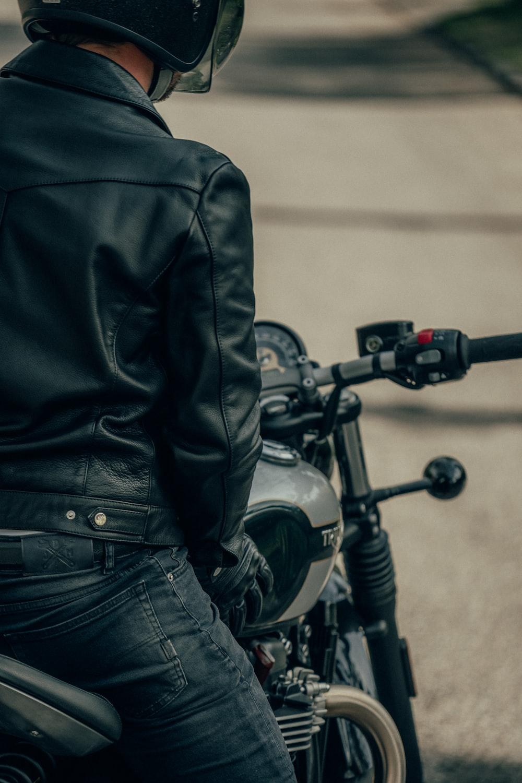 black motorcycle with black leather jacket